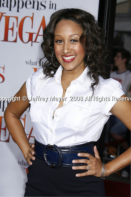 "Actress Tamara Mowry arrives at the Premiere Of Fox's ""What Happens In Vegas"" on May 1, 2008 at the Mann Village Theatre in Los Angeles, California."