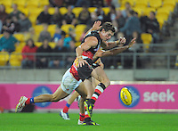 St Kilda's Lenny Hayes kicks for goal during the Australian Rules Football ANZAC Day match between St Kilda Saints and Brisbane Lions at Westpac Stadium, Wellington, New Zealand on Friday, 25 April 2014. Photo: Dave Lintott / lintottphoto.co.nz