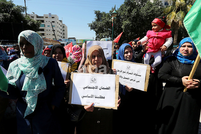 Palestinian supporters of Popular front for Liberation of Palestine (PFLP) hold banners during a protest against the siege of Gaza, in Gaza City, on April 2, 2016. Photo by Mohammed Asad