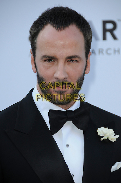 TOM FORD.arrivals at amfAR's Cinema Against AIDS 2010 benefit gala at the Hotel du Cap, Antibes, Cannes, France during the Cannes Film Festival.20th May 2010.amfAR portrait headshot black bow tie beard facial hair tuxedo tux flower corsage .CAP/CAS.©Bob Cass/Capital Pictures.