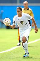 2 October 2011:  FIU defender Christian Melean (6) returns the ball to play in the first half as the FIU Golden Panthers defeated the University of Kentucky Wildcats, 1-0 in overtime, at University Park Stadium in Miami, Florida.