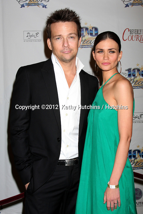 "LOS ANGELES - FEB 26:  Sean Patrick Flanery; Lauren Hill arrives at the ""Night of a 100 Stars"" Oscar Viewing Party at the Beverly Hills Hotel on February 26, 2012 in Beverly Hills, CA."