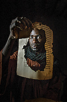 Boubacar Sadeck, the last calligrapher in Timbuktu holds ancient manuscripts that his family owns in his home. After Islamic militants launched a campaign to eradicate historic vestiges of a medieval Muslim civilization that they deemed un-Islamic, international scholars feared the worst: that the militants had torched the Ahmed Baba Institute, home to 30,000 priceless items of scholarship dating back to the 13th century. But many volumes may have escaped destruction by being hidden from fundamentalist forces that seized the north last year. /Felix Features