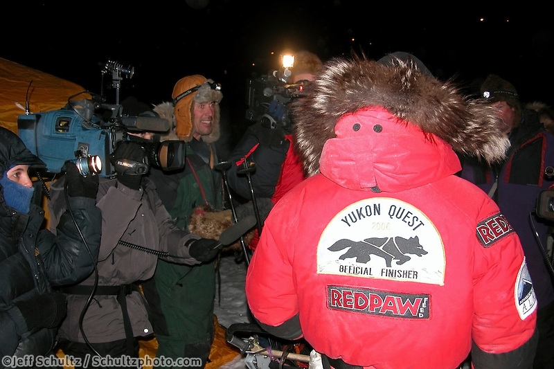 The media descend on Lance Mackey at 1:40 a.m. Tuesday in White Mountain. Photo by Jon Little.