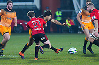 Jaguares' Felipe Ezcurra kicks past Crusaders' Mitchell Drummond during the 2019 Super Rugby final between the Crusaders and Jaguares at Orangetheory Stadium in Christchurch, New Zealand on Saturday, 6 July 2019. Photo: Dave Lintott / lintottphoto.co.nz