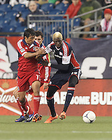 New England Revolution forward Saer Sene (39) battles for the ball. In a Major League Soccer (MLS) match, the New England Revolution defeated Chicago Fire, 2-0, at Gillette Stadium on June 2, 2012.
