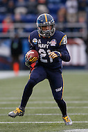Annapolis, MD - December 28, 2015:    Navy Midshipmen running back DeBrandon Sanders (21) runs the ball during the Military Bowl game between Pitt vs Navy at Navy-Marine Corps Memorial Stadium in Annapolis, MD. (Photo by Elliott Brown/Media Images International)