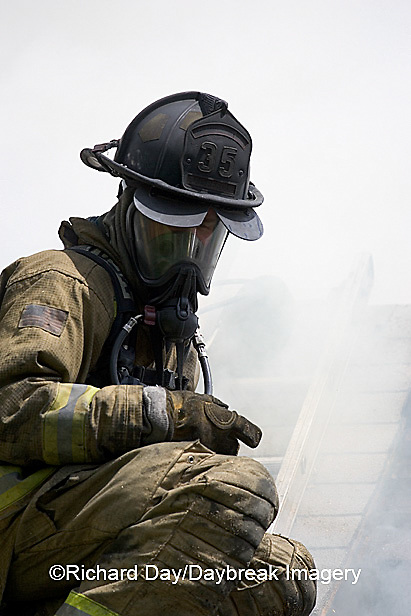 63818-021.13 Firefighter on roof at house fire,  Marion Co. IL