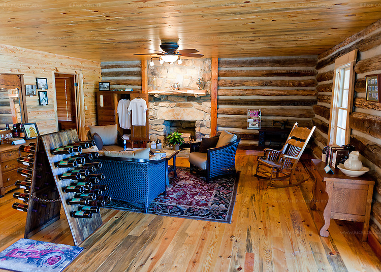 The tasting room at The Homeplace Vineyard has a  comfortable living room complete with fireplace.