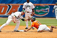 May 31, 2009:  NCAA Division 1 Gainesville Regional:     Jacksonville 2B Chuck Opachich (10) fails to tag Miami  DH Ted Blackman (31) during 2nd round regional action at Alfred A. McKethan Stadium on the campus of University of Florida in Gainesville.  Miami Hurricanes eliminated Jacksonville 4-0 and will advance to the finals against Florida............