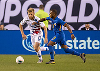 PHILADELPHIA, PA - JUNE 30: Tim Ream #13 and Gevaro Nepomuceno #11 contest the ball during a game between Curaçao and USMNT at Lincoln Financial Field on June 30, 2019 in Philadelphia, Pennsylvania.