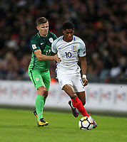 Marcus Rashford of England and Roman Bezjak of Slovenia<br /> <br /> Photographer Rob Newell/CameraSport<br /> <br /> FIFA World Cup Qualifying - European Region - Group F - England v Slovenia - Thursday 5th October 2017 - Wembley Stadium - London<br /> <br /> World Copyright &copy; 2017 CameraSport. All rights reserved. 43 Linden Ave. Countesthorpe. Leicester. England. LE8 5PG - Tel: +44 (0) 116 277 4147 - admin@camerasport.com - www.camerasport.com