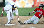 SIOUX FALLS, SD - JUNE 6:  Jared Clark #15 from the Sioux Falls Canaries attempts to put the tag on Josh Mazzola #13 from Winnipeg in the fourth inning Thursday night at the Sioux Falls Stadium. The ball got away from Clark and Mazzola scored on the play. (Photo by Dave Eggen/Inertia)