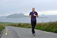 GAA History to be made: Kerry footballer Tomas O'Se pictured overlooking the Blasket Islands outside Dingle in County Kerry this week ahead of becoming the most 'capped' GAA footballer in the country surpassing his brother Darragh with 82 championships appearances when he lines out against Clare on Saturday. Tomas first played in the Munster semi-final against Cork in Killarney in July 1998. He has worn the no5 jersey at half back on most occassions, a position made famous also by his uncle Paidi O'Se. He holds 5 All-Ireland medals and 8 Munster championships.<br /> Picture by Don MacMonagle