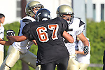 Beverly Hills, CA 09/23/11 - Rory Hubbard (Peninsula #33) and Justin Jimena (Peninsula #79) and unknown Beverly Hills player(s) in action during the Peninsula-Beverly Hills frosh football game at Beverly Hills High School.