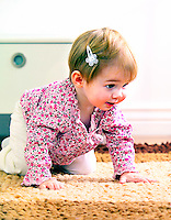 Toddler baby learning to crawl