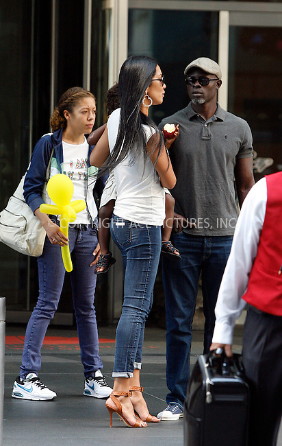 WWW.ACEPIXS.COM . . . . .  ....August 2 2011, New York City....Model Kimora Lee and her partner actor Djimon Hounsou carry their son Kenzo out of a midtown hotel on August 2 2011 in New York City....Please byline: CURTIS MEANS - ACE PICTURES.... *** ***..Ace Pictures, Inc:  ..Philip Vaughan (212) 243-8787 or (646) 679 0430..e-mail: info@acepixs.com..web: http://www.acepixs.com