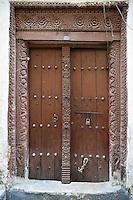 Zanzibar, Tanzania.  Arab-Style Wooden Door, Stone Town.