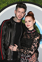 LOS ANGELES, CA - DECEMBER 7: Travis Mills, Madelaine Petsch, at 2017 GQ Men Of The Year Party at Chateau Marmont in Los Angeles, California on December 7, 2017. Credit: Faye Sadou/MediaPunch /nortephoto.com NORTEPHOTOMEXICO