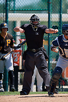 Home plate umpire Kevin Levine calls strike three during a Florida Instructional League game between the Detroit Tigers and the Pittsburgh Pirates on October 2, 2018 at the Pirate City in Bradenton, Florida.  (Mike Janes/Four Seam Images)
