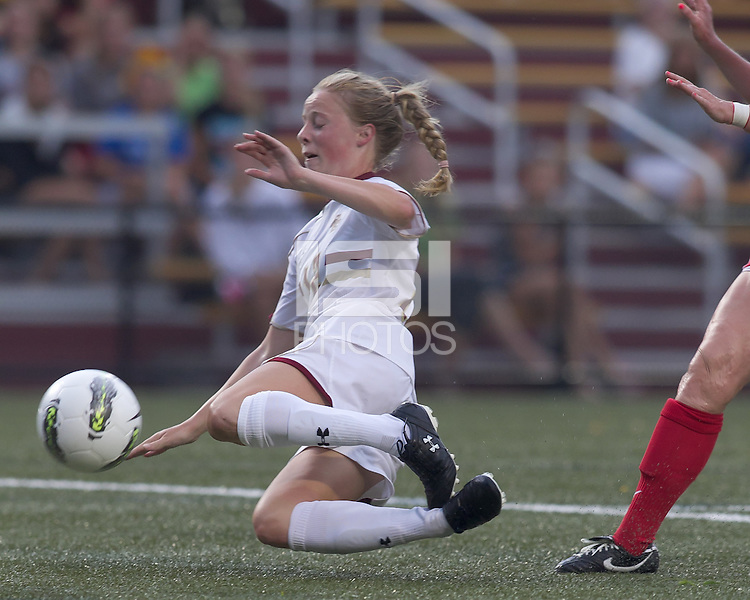 After being tripped up, Boston College midfielder Julia Bouchelle (12) still tries to score. After 2 complete overtime periods, Boston College tied Boston University, 1-1, after 2 overtime periods at Newton Soccer Field, August 19, 2011.