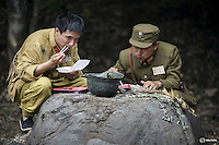 "Actors dressed as Chinese World War Two soldiers eat their lunch on the set of ""The Last Prince"" television series on location near Hengdian World Studios near Hengdian July 24, 2015. Hundreds of well-trained actors and other professionals are available at the Hengdian World Studios. The well-organised team coordinate complicated battle scenes to satisfy the huge appetite for productions about the war against Japan. Director Li Xiaoqiang said the series is about a Qing Dynasty prince, who joined the Chinese nationalist army after suffering family misfortune. ""After he learnt more about the Communist Party, the prince began to understand what real revolution and the anti-Japanese war meant, and turned to the Communist Party to fight Japan"", the director added. According to local media, more than 10 new movies, 12 TV dramas, 20 documentaries and 183 war-themed stage performances will be released in China to coincide with the 70th anniversary of the end of World War Two. REUTERS/Damir SagoljPICTURE 16 OF 28 FOR WIDER IMAGE STORY ""BEHIND THE SCENES OF A CHINESE WAR DRAMA"".SEARCH ""SAGOLJ STUDIO"" FOR ALL PICTURES."