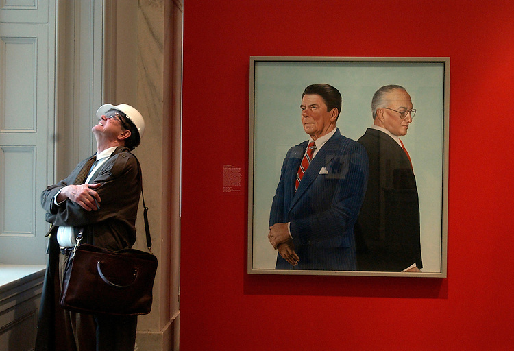 Benjamin Forgey of the Washington Post checks out a window sill in National Portrait Gallery and the Smithsonian American Art Museum, during a walk through of the museum that is scheduled to open July 1, 2006, after a six year renovation project.  A portrait of Ronald Reagan and Mikhail Gorbachev, is on display.