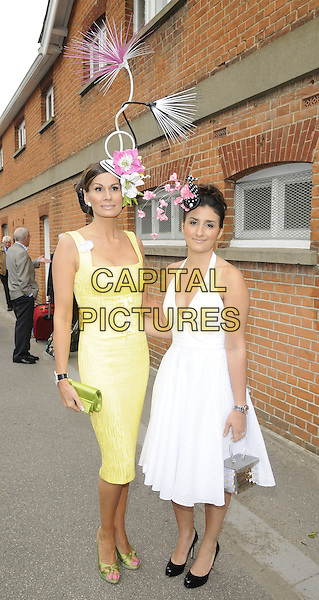 ISABELLA CHRISTENSSEN & SOPHIE CHRISTENSSEN.The Royal Ascot Day 1, Ascot, Berkshire, England..June 15th, 2010.full length white dress halterneck yellow green clutch bag flowers shoes silver box purse mother mom mum daughter family hat hats Isabell Kristensen black pink christensen.CAP/CAN.©Can Nguyen/Capital Pictures.