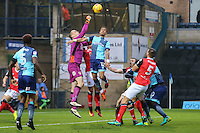 Goalkeeper Barry Roche of Morecambe clears the ball under pressure from Paris Cowan-Hall of Wycombe Wanderers during the Sky Bet League 2 match between Wycombe Wanderers and Morecambe at Adams Park, High Wycombe, England on 12 November 2016. Photo by David Horn.