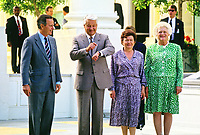 United States President George H.W. Bush says farewell to President Boris Yeltsin of the Russian Federation on the North Portico of the White House in Washington, DC  on June 18, 1992.  From left to right: President Bush, President Yeltsin, Naina Yeltsina, and first lady Barbara Bush.<br /> CAP/MPI/RS<br /> &copy;RS/MPI/Capital Pictures