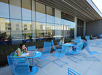NWA Democrat-Gazette/ANDY SHUPE<br /> Students work Tuesday, Sept. 15, 2015, outside the newly opened and dedicated Champions Hall on the University of Arkansas campus in Fayetteville. The $26.5 million, 62,000-square-foot structure is home to biology labs, general purpose classrooms, and the Math Resource and Teaching Center. The athletics department allocated a portion of the university's annual share of Southeastern Conference revenues to pay off the approximately $18 million in bonds that were issued to build the facility.