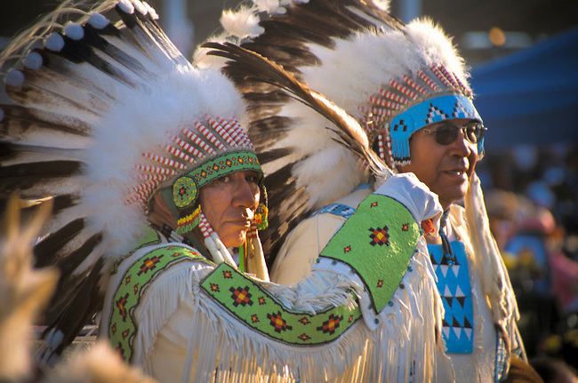 Two Blackfeet men dressed in traditional eagle feather headdress warbonnets and beaded regalia during the annual Indian Days Festival in Browning Montana