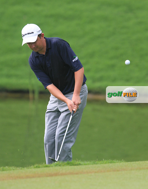 Peter Lawrie (IRL) chips onto the 15th green on Day 1 of the Maybank Malaysian Open 2012 at Kuala Lumpur Golf and Country Club, Kuala Lumpur, Malaysia...(Photo Jenny Matthews/www.golffile.ie)