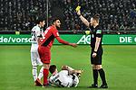 15.03.2019, Borussia-Park - Stadion, Moenchengladbach, GER, DFL, 1. BL, Borussia Moenchengladbach vs SC Freiburg, DFL regulations prohibit any use of photographs as image sequences and/or quasi-video<br /> <br /> im Bild Gelb / gelbe Karte fuer Vinzenzo Grifo (#32, SC Freiburg) von Dr. Robert Kampka (SR) (Schiedsrichter, referee), <br /> <br /> Foto © nph/Mauelshagen