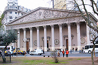 El Catedral, The Cathedral Metropolitan in roman style with pillars, traffic in front of it on Plaza de Mayo May Square. Buenos Aires Argentina, South America