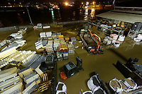 Pictured: A flooded builders' merchants by river Towy in Carmarthen, Wales, UK. Saturday 13 October 2018<br /> Re: River Towy has burst its banks and adjacent properties have flooded, caused by storm Callum, in Carmarthen, west Wales, UK.