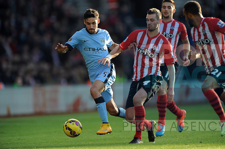 Jesus Navas of Manchester City is challenged by Morgan Schneiderlin of Southampton<br /> - Barclays Premier League - Southampton vs Manchester City - St Mary's Stadium - Southampton - England - 30th November 2014 - Pic Robin Parker/Sportimage