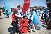 MOSCOW, RUSSIA - June 16, 2018: An Argentina fan buys water from a vendor outside Spartak stadium before the Iceland vs. Argentina game at the 2018 FIFA World Cup.