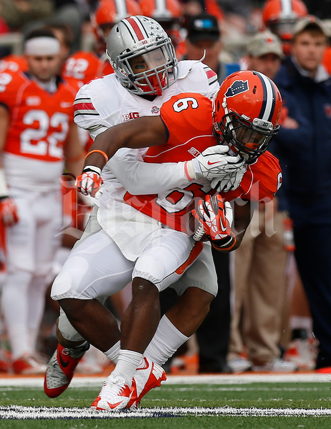 Illinois Fighting Illini running back Josh Ferguson (6) is grabbed by Ohio State Buckeyes linebacker Ryan Shazier (2) during Saturday's NCAA Division I football game at Memorial Stadium in Champaign, Il., on November 16, 2013. Ohio State won the game 60-35. (Barbara J. Perenic/The Columbus Dispatch)