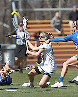 Boston College midfielder Kate McCarthy (20) scores as she falls to the ground.Boston College (white) defeated Duke University, 10-9, at Newton Campus Lacrosse Field, on April 6, 2013.