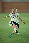 Vicky Krug (4) of the Wake Forest Demon Deacons kicks the ball during first half action against the South Carolina Gamecocks at Spry Soccer Stadium on August 24, 2017 in Winston-Salem, North Carolina.  The Demon Deacons defeated the Gamecocks 3-2.  (Brian Westerholt/Sports On Film)
