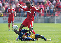 27 April 2013:Toronto FC defender Ashtone Morgan #5 and New York Red Bulls midfielder Lloyd Sam #10 in action during the first half in an MLS game between the New York Red Bulls and Toronto FC at BMO Field in Toronto, Ontario Canada....