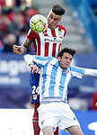 Atletico de Madrid's Jose Maria Gimenez (t) and Malaga CF's Duje Cop during La Liga match. April 23,2016. (ALTERPHOTOS/Acero)