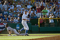 UCLA 3B Dean Espy looks to the umpires for a call in Game One of the NCAA Division One Men's College World Series Finals on June 28th, 2010 at Johnny Rosenblatt Stadium in Omaha, Nebraska.  (Photo by Andrew Woolley / Four Seam Images)
