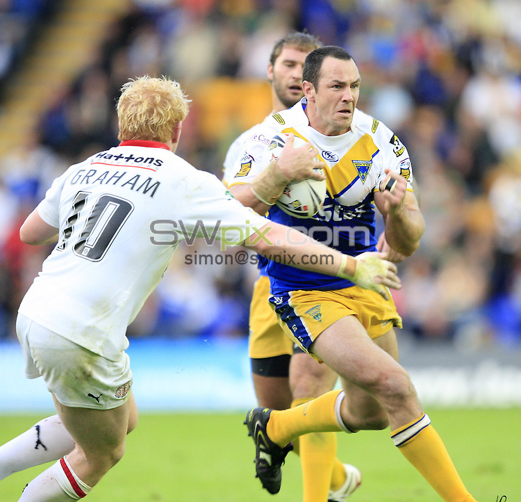 Pix: Chris Mangnall /SWPix.com, Rugby League, Super League. 31/07/10  Warrington Wolves v St Helens Saints....picture copyright>>Simon Wilkinson>>07811267 706>>....Warrington's Adrian Morley  tackled by St Helens's James Graham