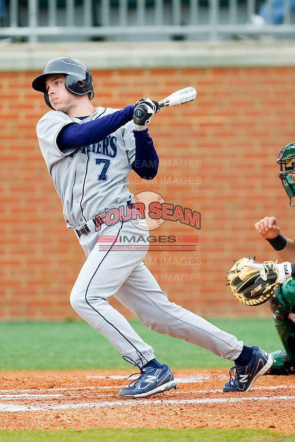 Preston Aldridge #7 of the Saint Peter's Peacocks follows through on his swing against the Charlotte 49ers at Robert and Mariam Hayes Stadium on February 18, 2012 in Charlotte, North Carolina.  Brian Westerholt / Four Seam Images