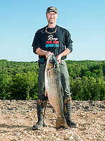 Winner of the 2014 Bass Pro U.S. Open Bowfishing Championship, Brian Ellenburg (cq), after his weigh in, Sunday, May 4, 2014. They caught 354.4 pounds of carp during the competition.<br /> <br /> Photo by Matt Nager
