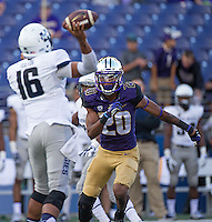 Husky cornerback Kevin King applies pressure on Aggie quarterback Chuckie Keeton.