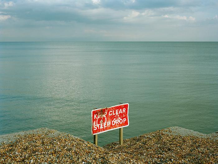 A sign on a groyne on Brighton beach. England.