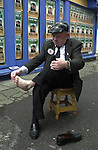 TITLE; OH MY ACHING FEET<br />Jackie Healy-Rae rubs his feet after a long campaign in 2002.<br />One of the images from Don MacMonagle's book of 100 photographs of Deputy Jackie Healy-Rae entitled 'Jackie - Keeping Up Appearance'.<br />Picture by Don MacMonagle